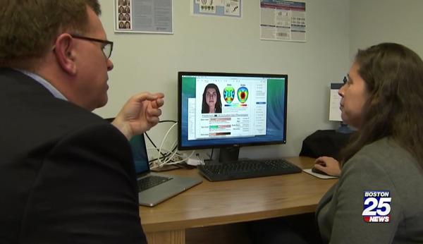 [IMAGE] Investigative Reporter Bob Ward Examines a Snapshot Composite Profile